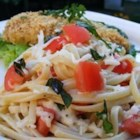 "Tony's Summer Pasta - ""Tony is my husband. He brought home a recipe he had gotten from someone at work, and it was adapted over time to this recipe--so I named it Tony's Summer Pasta. The tomatoes and cheese are marinated in oil, basil, and garlic, and then tossed with the hot linguine. The tomatoes are warmed and the cheese melts ever so slightly, creating a simple but delectable meal."""
