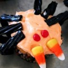 Spider Cupcakes - Chocolate cupcakes with licorice legs, candy corn fangs, and red hot eyes -- perfect for Halloween.