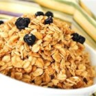 Coconut Granola - A quick, easy, and very delicious recipe that can be eaten for cold cereal, topping on yogurt or even for a snack. Because it does a better job that honey, I use part maltose syrup (purchased at Asian markets) to help bind the ingredients together instead of using all honey. Virgin coconut oil has many healthy properties and enhances the taste of the granola, but if that cannot be found you can substitute it with any other oil. Enjoy!