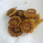 Tostones - Fried plantains are cut into chips for another fantastic little appetizer from Puerto Rico. Tostones may be served with ketchup (kid's favorite) or with garlic in olive oil.