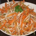 Carrot-Bean Sprouts Salad - Carrots and bean sprouts are tossed with fresh coconut, cilantro, and a simple dressing made with lemon juice, sugar, and toasted mustard seeds.