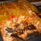 Taco Lasagna - Frilly lasagna noodles are layered with Cheddar cheese and a meaty tomato sauce flavored with taco seasoning. Microwave this tasty casserole, and top with a crunchy layer of tortilla chips.