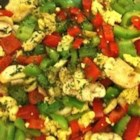 Scrambled Tofu - Tomatoes, green onion, and Cheddar cheese make this protein-packed tofu scramble a tasty breakfast. You're family won't miss the eggs!