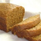 Holiday Pumpkin Bread - A fragrant array of spices -cinnamon, nutmeg, cloves and allspice -accent this moist pumpkin-nut bread peppered with juicy raisins.  The generous recipe makes three loaves, so plan on giving some away to friends and family.