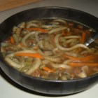 Asian Mushroom Soup - Assorted mushrooms, vegetables, chicken, and noodles mingle well in this hearty and healthy soup.