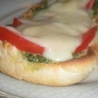 Basil Pesto Bread - At a recent party our friends went wild over this. A simple pesto is spread on Italian bread and layered with roma tomatoes and cheese. It takes a little time, but it is worth it.  I freeze the basil in ice cube trays, then put the cubes in freezer bags. You can easily take out and thaw what you need. Enjoy!