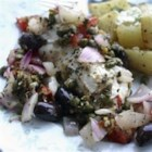 Easy Mediterranean Fish - The flavors of Greece are combined with halibut and baked in an aluminum foil pouch.