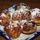 Dansk Aebleskiver (Danish Doughnuts) - Cooked in a special cast iron or electric griddle with seven to nine cups, these traditional Danish dumplings are round, doughnut-like pastries dusted with confectioners' sugar and eaten with a dollop of raspberry or strawberry jam.