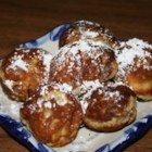 Laura's Famous Aebleskiver - This traditional Danish breakfast treat made with a special aebleskiver pan is a cross between a pancake and a popover. Sprinkle with confectioners sugar or drizzle with maple syrup or jam.