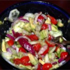 Cucumber Avocado Salad - A recipe for a refreshing salad: Paper-thin slices of cucumber and red onion are seasoned with dill, garlic, salt, and sugar, then tossed with chopped avocado and red wine vinegar.