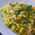 Warm Corn Salad - Fresh corn kernels and onions are warmed in butter with a sprinkling of parsley. Garnish this sweet side salad with chives, and serve with your favorite steak hot off the grill!