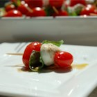 Tomato and Mozzarella Bites - A great way to serve tomato mozzarella salad.  Great presentation.  Always a hit. You can find the bite-sized mozzarella at most supermarkets.  If they are on the larger side, cut them in half.