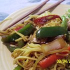 Vegetable Lo Mein - Whip up a zesty blend of hoisin sauce, honey, soy, ginger, cayenne and curry powder to flavor this fabulous stir fry of mushrooms, carrots, peppers, onion, garlic, bean sprouts and green onion. Toss with hot spaghetti.