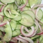Cucumber Crunch Salad - This cucumbers and red onion salad has the flavor of a fresh sweet pickle. Serve as is, spoon over grilled hamburgers, or layer between two slices of cheese in a grilled cheese sandwich.