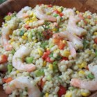 Barley, Shrimp, and Corn Salad - A lightly seasoned oil and lemon juice dressing perfectly accents the flavors of this salad made with barley, shrimp, and red and green bell peppers.