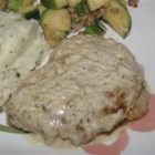 Creamy Pork with Sour Cream Sauce - Pork cube steaks are coated in seasoned bread crumbs, fried to a golden brown, then baked with sauteed mushrooms in a delicious sour cream, broth, and cream of chicken soup sauce.