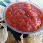 Roasted Tomato Salsa I - This chunky, smoky salsa tastes amazing with tortilla chips. Roasted tomatoes, garlic, onion and jalapeno are blended with cilantro and cumin to create one of the tastiest and easiest Mexican-inspired recipes you'll ever try.