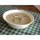 Easy Corn and Crab Chowder - Creamed corn and crab meat intermingle with white wine, small bits of bacon, and cubes of potatoes in this soup. Try the chicken curry variation for a more piquant  experience.