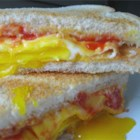 Fried Egg Sandwich - You'll never buy a fast food breakfast again once you've learned how to make these quick and easy egg and cheese sandwiches in your own kitchen.