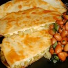 Tortillas with Cactus and Cheese - Tortillas are stuffed with tender nopales (cactus) seasoned with adobo seasoning, Cheddar cheese, and cilantro,