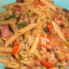 Penne with Pancetta, Tuna, and White Wine - This is a fresh-tasting pasta dish loaded with good stuff! Pancetta, peas, mushrooms, spinach, flaked tuna, and cherry tomatoes are cooked in a bright-tasting white wine and lemon juice sauce.