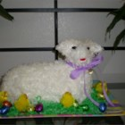 Easter Lamb Pound Cake - An Easter favorite, this pound cake pairs bourbon and pecans in a recipe handed down through the generations. Decorate with frosting, and jelly beans for the eyes and nose. Cover frosting with shredded coconut, if desired.