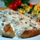 Pan Fried Halibut Steak with Light Green Sauce - A delightful and rich halibut recipe with a memorable herbed white wine cream sauce.