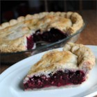 Hot Water Pie Crust II - This recipe yields a tender, flaky pie crust every time. Flour, shortening, hot water, cornstarch, vinegar, and milk will help you do the trick. The dry ingredients are stirred into the liquid ingredients and the dough is rolled between sheets of waxed paper. This recipe yields two double crusts.