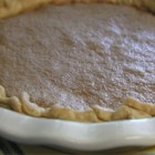 Chess Pie III -  This is a rich, flavorful pie that 's like eating a pecan pie without the pecans. Along with the sugar, butter and eggs, this recipe calls for cornmeal, vinegar and vanilla.