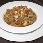 Spicy Sausage Soup with Cilantro - An easy yet hearty and outstanding soup of hot Italian sausage, vegetables, and cilantro. A very popular dish appealing to sight, taste and aroma. Serve with warm rye rolls or bread sticks.