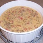 Kevin's Sausage Dip - Cream cheese and diced tomatoes with green chiles go well together with sausage in this dip that is sure to please. Serve with your favorite chips.