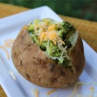Microwave Baked Potato - Fix yourself a yummy baked potato with a slow-roasted taste in just 12 minutes with this simple microwave recipe for a potato with the fixin's.