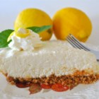 Lemon Icebox Pie III -  Cream cheese, condensed milk, lemon juice and rind is stirred up in a bowl until smooth, poured into a graham cracker crust, and then chilled.