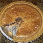 Chocolate Chip Pie III -  Simple, chocolaty and studded with pecans, this decadent pie is a pleasure and a cinch to make. Butter, eggs, flour, and sugar join the chocolate and pecans, and bake up into a delicious pie.