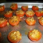 Baked Cherry Tomatoes with Garlic - Succulent cherry tomatoes are baked with a sliver of garlic inside. Optionally drizzle with olive oil and/or sprinkle with salt. You may wish to serve these with toothpicks. Perfect for the party on the patio!