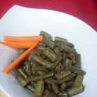 Allspice String Beans - Green beans are boiled until soft in an engaging mixture of allspice and garlic.