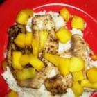 Mahi Mahi with Coconut Rice and Mango Salsa - Mahi mahi is broiled to perfection and served on a bed of fragrant jasmine rice with a warm mango sauce.