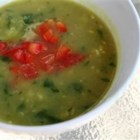 Jamaican Spinach Soup - This vegetable broth-based soup is a smooth puree made with potatoes, zucchini, and spinach, with just enough spice.