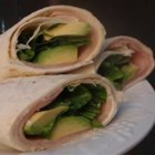 Smoked Turkey Tortilla Wraps - These whole wheat, turkey, and avocado wraps are a great way to use leftover smoked turkey. My kids have always liked the leftovers as much as the 'firstovers'! These are different but yummy.