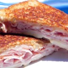 Christy's Awesome Hot Ham and Cheese - Swiss cheese and ham are grilled on whole grain bread for this easy, hot sandwich.