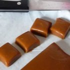 Caramels - Satiny-smooth, homemade caramels are a snap with this easy recipe! Just be sure you have a candy thermometer on hand as you simmer sugar, corn syrup, evaporated milk, whipping cream and butter. Cool in a pan, then cut into squares.