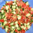 Fava Bean Salad - You can prepare this flavorful fava bean salad made with tomatoes, onion, and cucumber tossed with fresh parsley, lemon juice and olive oil in minutes. Makes a great, simple, side dish for traditional Middle Eastern meals.