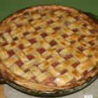 Fast Apple Rhubarb Pie - This pie bakes up sweet and rosy pink with its nice mingling of diced apples and rhubarb. The fruit is sweetened with sugar and a splash of cinnamon, and then its turned into an unbaked pie crust. Forty minutes later it 's baked and ready for a dollop of whipped cream.