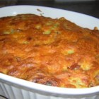 Corn Dog Casserole - Browned hot dog pieces mixed with celery, green onion, a corn bread batter and Cheddar cheese for a taste of the county fair in a casserole!