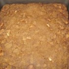 German Apple Pudding Cake - A fresh apple cake with nuts and raisins that, after baking, but still hot, has a cooked caramel-like topping poured over it. If using a glass baking dish, reduce oven temperature by 25 degrees.
