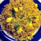 Poor Man's Fried Rice - This is a quick and easy version of an all-time favorite.  Instant rice is cooked with scrambled eggs, soy sauce, ginger and green onions.