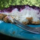 Easy Cream Cheese Pie - Sweetened condensed milk makes this pie velvety, and the lemon juice compliments the cream cheese beautifully. Along with the cream cheese, these ingredients are stirred together, poured into a graham cracker crust, topped with cherry pie filling and chilled.