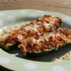 Zucchini Skins - Inspired by twice-baked potatoes, zucchini are stuffed with cheese and bacon bits and then broiled to make a tasty appetizer or side dish.