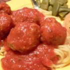 Jenn's Out Of This World Spaghetti and Meatballs - This authentic spaghetti and meatballs recipe is made with fresh oregano and parsley. Because the meatballs are cooked in the sauce, they are tender and savory.