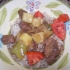 Slow Cooker Island Beef - Sweet and sour beef with pineapple, red and green bell peppers, and fresh tomatoes is easy to make in the slow cooker.